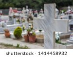 Marble cross in cemetery. tomb...