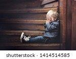 sad child  sitting on a... | Shutterstock . vector #1414514585