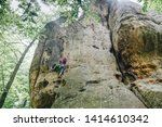 female climber hanging by a... | Shutterstock . vector #1414610342