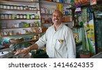 Small photo of Landour, Uttarakhand / India - July 27 2016: A shop owner stands at his shop in the char dukan (four shops) area in the town of Landour