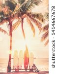 surfboard and palm tree on... | Shutterstock . vector #1414667678