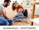 parents sitting on floor at... | Shutterstock . vector #1414726652