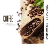 coffee beans and an old wooden... | Shutterstock . vector #141473002