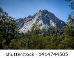 Beautiful view of majestic Tahquitz Peak on a clear sunny spring day with patches of snow remaining from the winter, Devils Slide Trail, San Jacinto Wilderness, Idyllwild-Pine Cove, California - stock photo