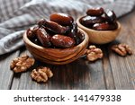 dates fruit in a wooden bowl... | Shutterstock . vector #141479338