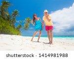 happy young couple having fun... | Shutterstock . vector #1414981988