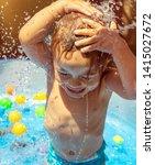 cheerful boy in waterpark... | Shutterstock . vector #1415027672
