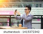 happy asian businessman selfie... | Shutterstock . vector #1415372342