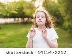 little redhead girl  raises...   Shutterstock . vector #1415472212