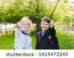 school girl and boy with white...   Shutterstock . vector #1415472245