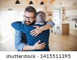 an adult son and senior father... | Shutterstock . vector #1415511395