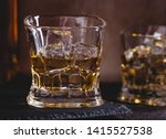 closeup of a glass of whiskey... | Shutterstock . vector #1415527538