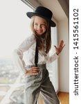 cute little girl with black hat ... | Shutterstock . vector #1415561102