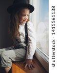 cute little girl with black hat ... | Shutterstock . vector #1415561138