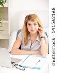 happy business woman sitting ... | Shutterstock . vector #141562168