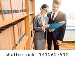 two lawyers in library of law... | Shutterstock . vector #1415657912