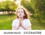 little redhead girl  raises her ...   Shutterstock . vector #1415666588