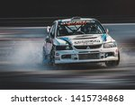 Small photo of Milan, Italy, June 03, 2018: Mitsubishi Lancer Evolution in action during the 1st Drift Show Il Destriero at the Iper Drive in Milan.