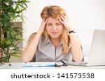 mature woman with headache... | Shutterstock . vector #141573538