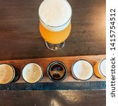 five tastings of beer in a... | Shutterstock . vector #1415754512