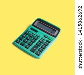 Small photo of Vintage pocket calculator, with both battery and solar power, and math operations limited to multiplication, division, addition, subtraction and square root. Isolated on a punchy pastel background