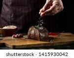 Chef Hands Cooking Meat Steak...