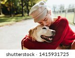 Stock photo stunning blonde with her beloved dog spending time together outdoor in the autumn beautiful 1415931725