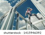 Shock Absorbing Lanyard and Safety Harness Equipment. Work at Height Safety. Caucasian Contractor on a Steel Building Frame. - stock photo