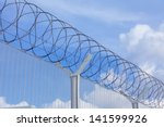 chain link fence with barbed... | Shutterstock . vector #141599926