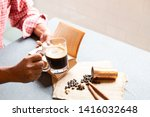 cropped shot of man holding a... | Shutterstock . vector #1416032648