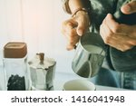 Close- up , Barista is steaming, milk frother latte art in coffee mug at home in the morning with sunset - stock photo