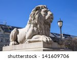 A Statue Of A Reclining Lion I...