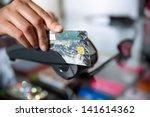female hand doing purchase... | Shutterstock . vector #141614362