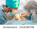 Small photo of Baldness treatment. Hair transplant. Surgeons in the operating room carry out hair transplant surgery. Surgical technique that moves hair follicles from a part of the head.