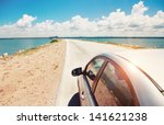 Car Driving Across Ocean By The ...