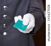 Stock photo hand of doorman giving key card to hotel room 141627028