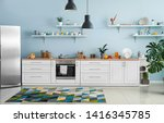 Small photo of Interior of modern comfortable kitchen