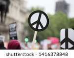 A Person Holds A Peace Sign...