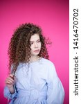 curly hair girl in blue blouse... | Shutterstock . vector #1416470702