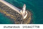 Aerial drone photo of iconic Venetian lighthouse in the entrance of picturesque old port of Chania at sunset with beautiful colours, Crete island, Greece