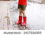 child wearing red rain boots...   Shutterstock . vector #1417026305