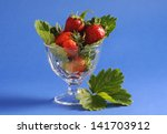 strawberries in the glass bowl... | Shutterstock . vector #141703912