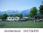 RV Park in Montana. Recreation Vehicles in the RV Park. Montana Mountains on the Horizon. Montana RV Trip. - stock photo