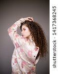 curly hair girl in jacket with... | Shutterstock . vector #1417368245