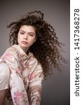 curly hair girl in jacket with... | Shutterstock . vector #1417368278