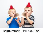 happy boys are blowing in... | Shutterstock . vector #1417583255