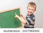 boy drawing with crayons on... | Shutterstock . vector #1417583342