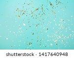 Golden Flying Sparkles On Blue...