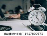 Alarm Clock On Wooden Table...