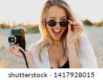 blond  playful woman holding...   Shutterstock . vector #1417928015